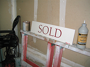 SOLD sign rider in garage.