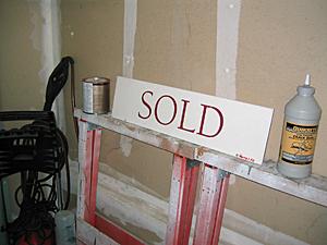 SOLD sign rider in garage.